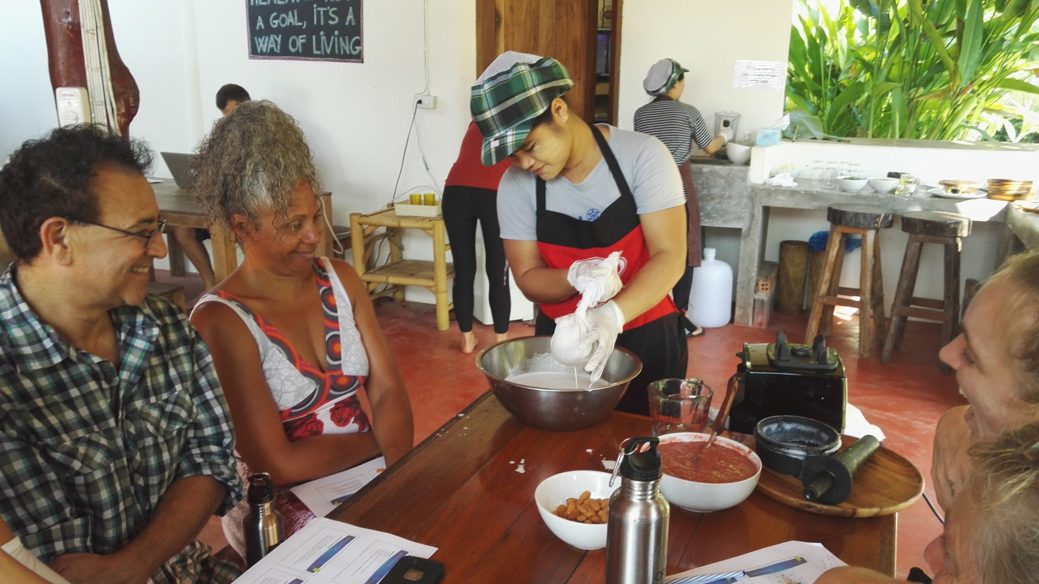 Making almond milk in the raw food cooking class