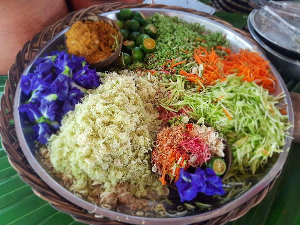 Ingredients for khao yam, or rice salad, at the market